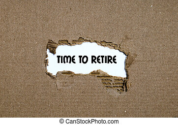 The word time to retire appearing behind torn paper