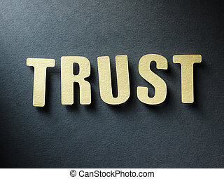 The word Trust on paper background