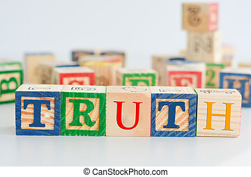"The word ""truth"" spelled with wooden letter cubes"