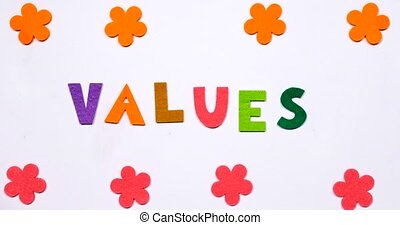 The word VALUES. Written in multi-colored dancing letters