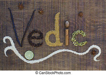 The word Vedic spelled out in a decorative way, with spices ...
