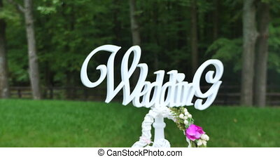 "the word ""wedding"" on a green background."