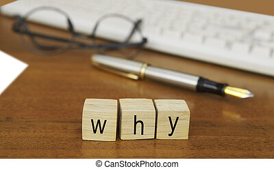 The word why on wood stamp