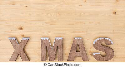 The word X MAS made on wood on wood