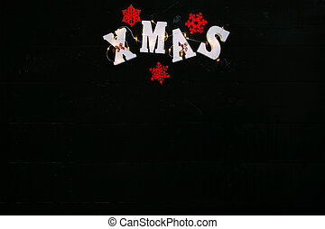The word Xmas on black background.