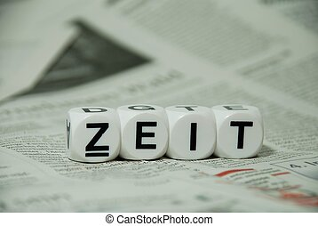 the word Zeit on a newspaper background - the german word...