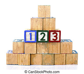 "The words ""123"" spelled out in wooded block on a white background with copy space"