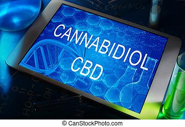 the words Cannabidiol (CBD) on a tablet with test tubes