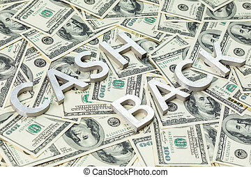 The words CASH BACK laid with aluminium thick letters on the US dollar bills background - with selective focus