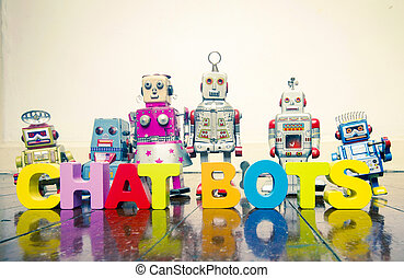 the words CHAT BOTS with wooden letters and retro toy robots on an old wooden floor