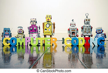 the words COMPUTER CODING with wooden letters and retro toy robots on an old wooden f