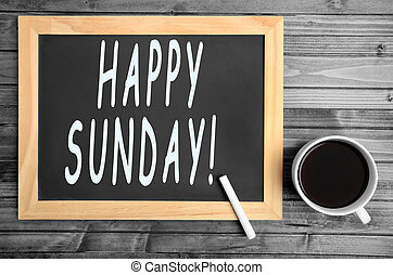 The words Happy Sunday on chalkboard