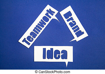 The words idea, teamwork and brand in speech bubbles