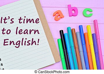 The words It's time to learn english on notebook
