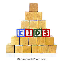 "The words ""KIDS"" spelled out in wooded block on a white background with copy space"