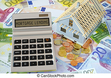 The Words -Mortgage lending on Calculator display - Pocket...