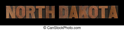 the words North Dakota in old wood type
