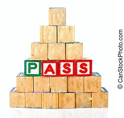"The words ""PASS"" spelled out in wooded block on a white background with copy space"