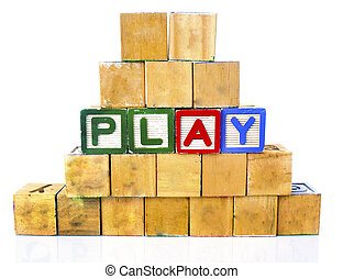 "The words ""PLAY"" spelled out in wooded block on a white background with copy space"
