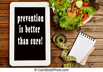 The words Prevention is better than cure on tablet pc