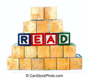 "The words ""READ"" spelled out in wooded block on a white background with copy space"
