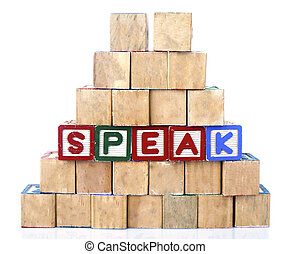 "The words ""SPEAK"" spelled out in wooded block on a white background with copy space"