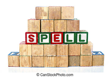 "The words ""SPELL"" spelled out in wooded block on a white background with copy space"