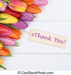 The words Thank You with tulips flowers