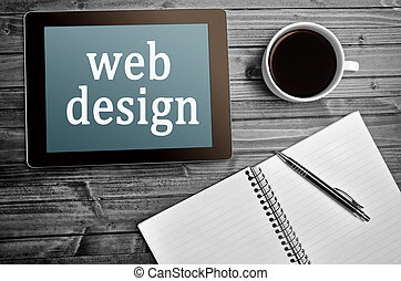 The words Web design on tablet