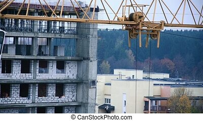 The work of a crane at a constructi
