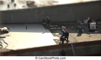 The work of builders. Laying tiles. Tilt shift. Time lapse