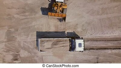 The work of loading equipment in the sand quarry