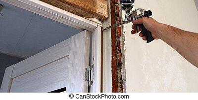 the work of the installer to fix the door frame
