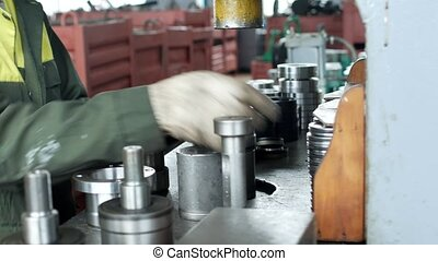 The worker at the plant presses the bearing into the hub...