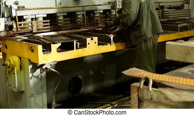 the worker is engaged in cutting of metal on the production automatic machine tool, metal cutting, press