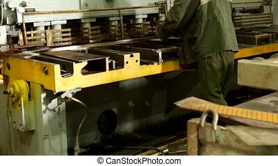 the worker is engaged in cutting of metal on the production automatic machine tool, metal cutting, production