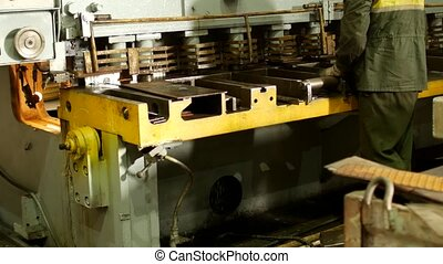 the worker is engaged in cutting of metal on the production automatic machine tool, metal cutting, machine