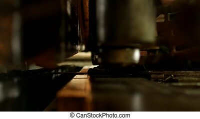 the worker is engaged in cutting of metal on the production automatic machine tool, metal cutting, operative