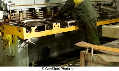 the worker is engaged in cutting of metal on the production automatic machine tool, metal cutting, detail