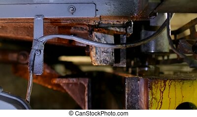 the worker is engaged in cutting of metal on the production automatic machine tool, metal cutting, manufacture