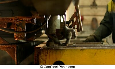 the worker is engaged in cutting of metal on the production automatic machine tool, metal cutting, engineering