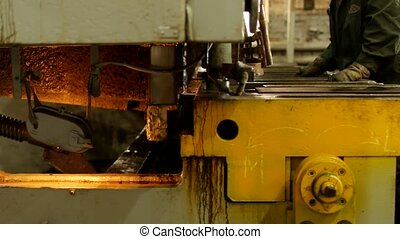 the worker is engaged in cutting of metal on the production automatic machine tool, metal cutting,manufacturing