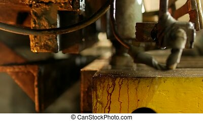 the worker is engaged in cutting of metal on the production automatic machine tool, metal cutting,manufacture