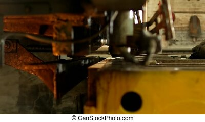 the worker is engaged in cutting of metal on the production automatic machine tool, metal cutting,tool