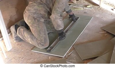The worker measures a plaster leaf