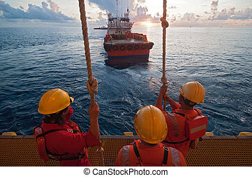 The workers prepare jump to the boat.