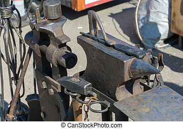 The workplace of the blacksmith - an anvil, a hammer, a...