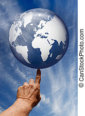 The World At Your Fingertips - Synthetic digital blue globe...