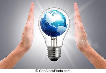 the world in light bulb on women hand - the world in light...