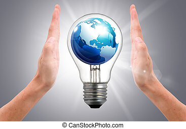 the world in light bulb on women hand - the world in light...